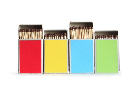 variegated: Few variegated matchboxes in a row isolated on white background.