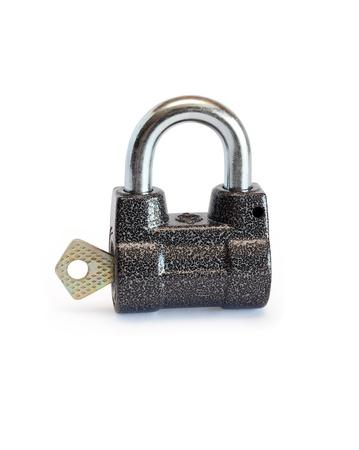 Key inserted into padlock on white background Stock Photo - 9735589