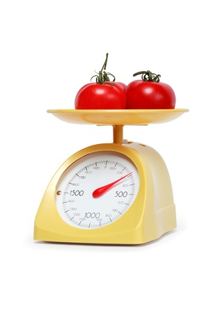 weighing scale: Three freshness tomatoes lying on weight scale. Isolated on white with clipping path