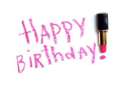 grooming product: Inscription Happy Birthday made with pink lipstick on white background