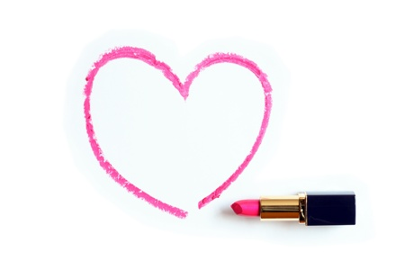 grooming product: Red lipstick near painted heart shape on white background