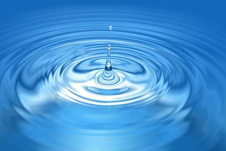 Drop above blue splashing water. Nice wallpaper Stock Photo