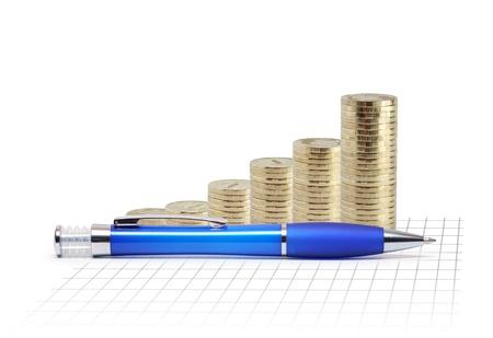 dynamic growth: Modern plastic blue ballpoint pen near coins columns and blank diagram