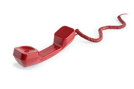 disconnection: Unhooking red telephone receiver with cable on white background Stock Photo
