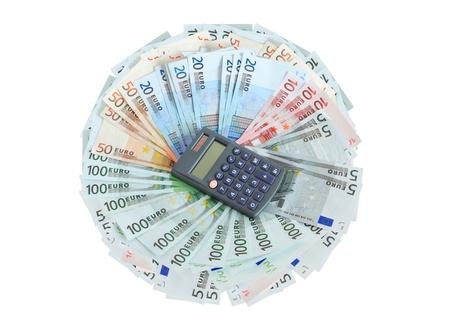 Ganancias concepto. Calculadora de mentir en el lote de la moneda de la Unión Europea Foto de archivo - 10929683