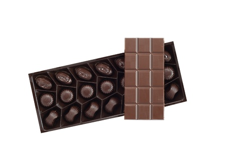 Bar of chocolate on box with candies Stock Photo - 11697459