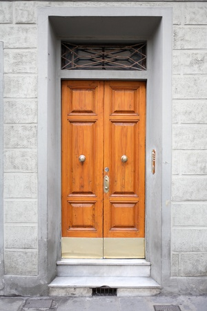 Fragment of old stone building with nice wooden door Stock Photo - 12041513