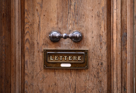 Closeup of nice wooden door with mail slot photo