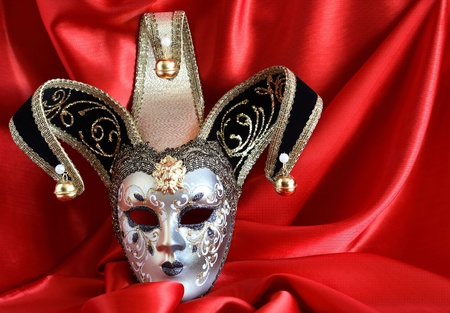 Closeup of classical venetian mask on red silk background photo