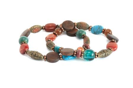 trinket: Costume Jewelry. Pair of nice vintage female bracelets on white background