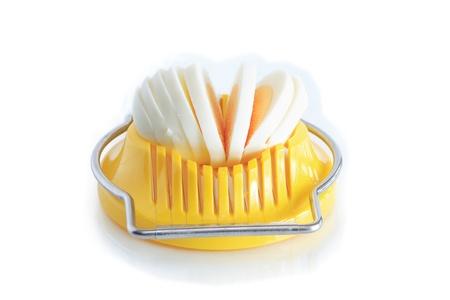 slicer: Modern yellow egg slicer on white background