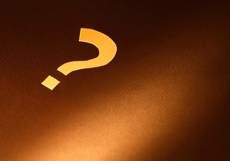 Problem concept. Luminous question mark cutting from cardboard surface Stock Photo - 12841227