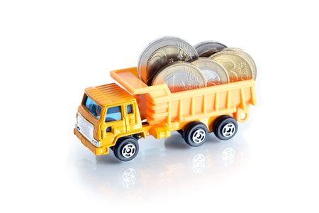 Business concept. Toy dump truck with European coins on white background Stock Photo - 12841235