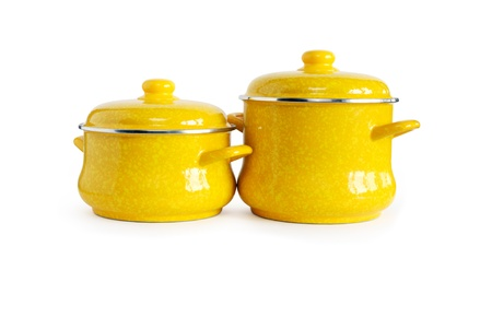 Two new yellow saucepans on white background. Clipping path is included Stock Photo - 13126859