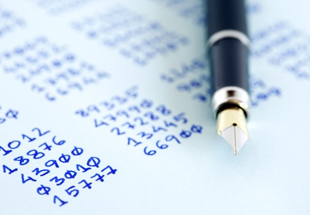 cryptogram: Closeup of fountain pen on paper with written numbers columns Stock Photo