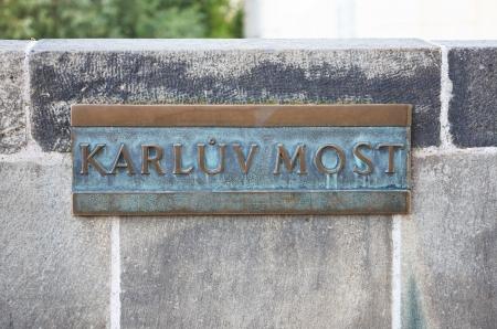Old bonze plate with inscription �Karluv Most� on Charles Bridge, Prague,Czech Republic photo