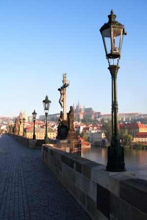 View of St. Vitus Cathedral from Charles Bridge at dawn, Prague,Czech Republic photo