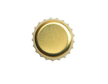 Yellow metal bottle cap on white background photo