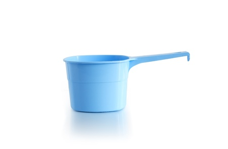 Blue empty plastic scoop on white background photo