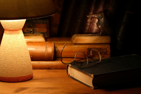 Vintage still life with old spectacles on book near desk lamp Stock Photo - 16567701