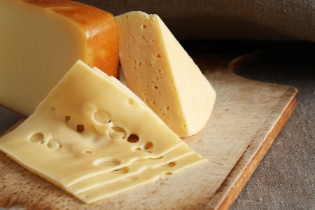hardboard: Still life with few sorts of cheese on wooden hardboard Stock Photo