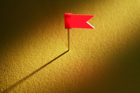 drawing pin: One drawing flag pin on nice yellow gradient background Stock Photo