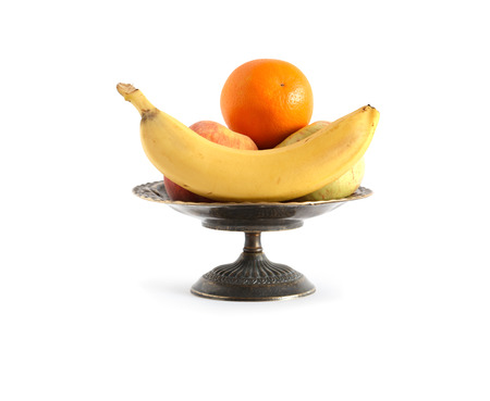 Nice metal fruit bowl full of various fruits on white background. Clipping path is included Stock Photo - 22993407
