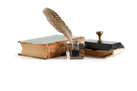 inkstand: Vintage still life. Old inkstand near book on white background