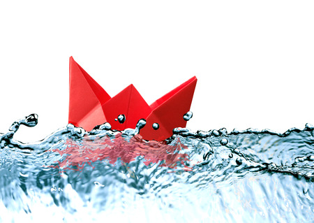 Freedom concept. Red paper boat on blue water with free space for text photo