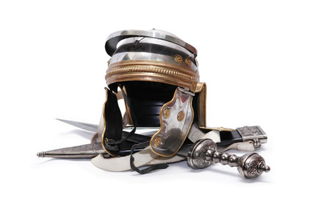 Ancient Roman military helmet near sword on white background