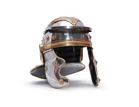Ancient Roman military helmet on white background.  Stock Photo