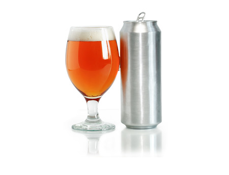 Open aluminum drink can near glass full of beer on white background. Clipping path is included photo