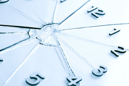 clock face: Digits as clock face on shattered glass background Stock Photo