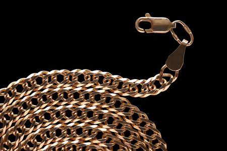 Gold chain closeup isolated on black background with clipping path photo