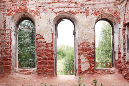 ruinous: Old brick ruinous country wall with door and windows