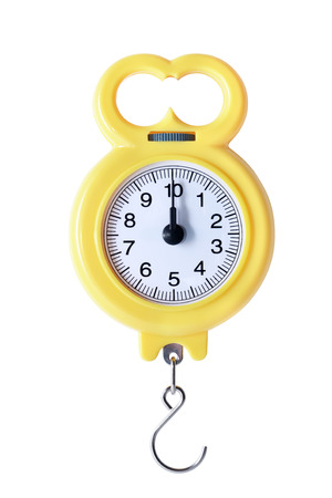 weigher: New yellow portable weigher on white background. Isolated with clipping path Stock Photo