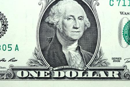 attainment: Closeup of ordinary One Dollar Bill fragment with Washington portrait at center Stock Photo