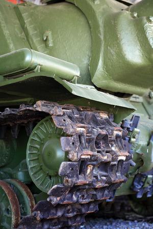 armoring: Military treat concept. Closeup of light tank crawler belt