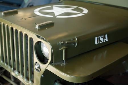 motorcar: TECHNICAL MUSEUM, CHERNOGOLOVKA, RUSSIA - MARCH 15, 2015: Closeup of famous American Legendary World War II Car. Willys JP allroad motor-car Editorial