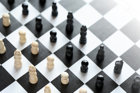 chessman: Black and white chessman set in a row on chessboard