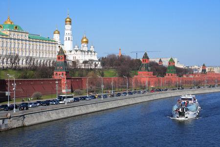 Moscow, Russia, April 12, 2015. Pleasure boat on Moskva River against the Kremlin and Kremlevskaya Embankment