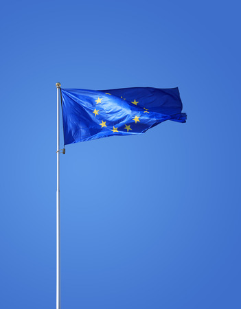 flagstaff: European Union flag on flagstaff waving against blue sky. Clipping path is included