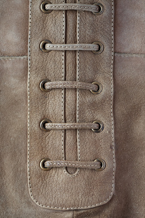 chamois leather: Closeup of gray suede background with lacing Stock Photo