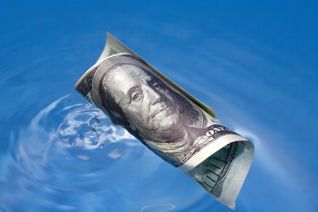 profundity: Closeup of one hundred USA dollar bill on waving water surface