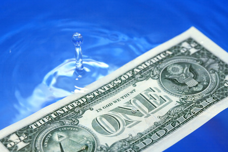 profundity: Closeup of one USA dollar bill on waving water surface Stock Photo