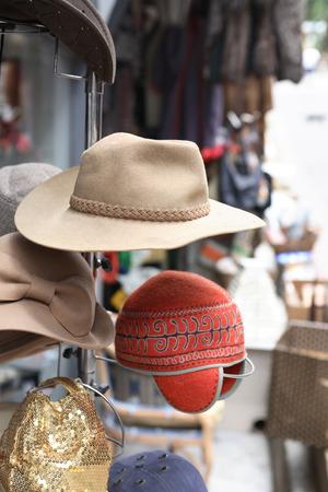 secondhand trade: Curiosity shop. Few vintage head-dress hanging in antique street market