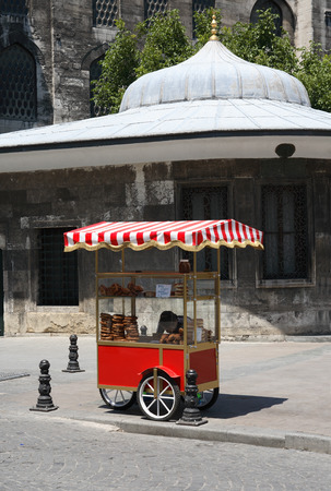 street market: Istanbul, Turkey � July 7, 2015: Nice red street market cart with freshness bread near New Mosque