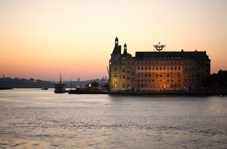 haydarpasa: Istanbul, Turkey � July 7, 2015: Haydarpasa railway station at sunset. View of Europe from Asia over Bosporus