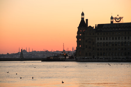 haydarpasa: Istanbul, Turkey - July 7, 2015: Haydarpasa railway station at sunset. View of Europe from Asia over Bosporus