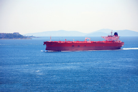 nautical   vessel: Big red ocean nautical vessel in the Sea of Marmara, Turkey Stock Photo